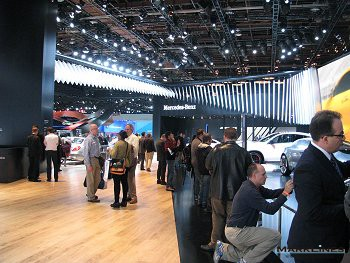 Visitors gather around Mercedes-Benz featured models