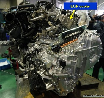 EGR cooler located in back of the engine