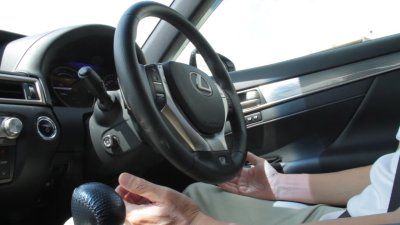 The driver's hands are off the steering wheel of the test vehicle for highway autonomous driving (courtesy of Toyota)