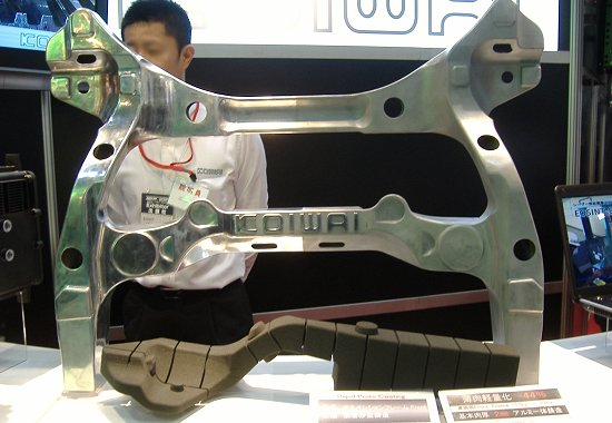 Koiwai's front suspension frame made by integral casting using 3D layered sand molds that achieve a 44% weight reduction