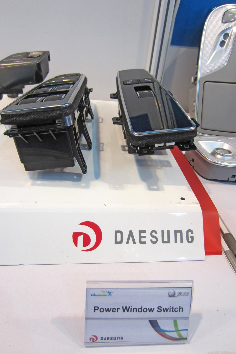 Ls Automotive Corp Formerly Daesung Electric Co Ltd Power Window Switch In The Raise Or Up Position Logo
